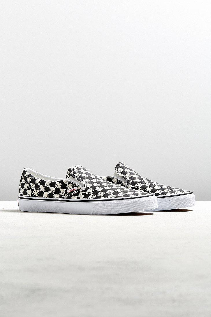 39f39a3d010a Lyst - Vans X Peanuts Classic Slip-on Snoopy Checkerboard Sneaker in ...