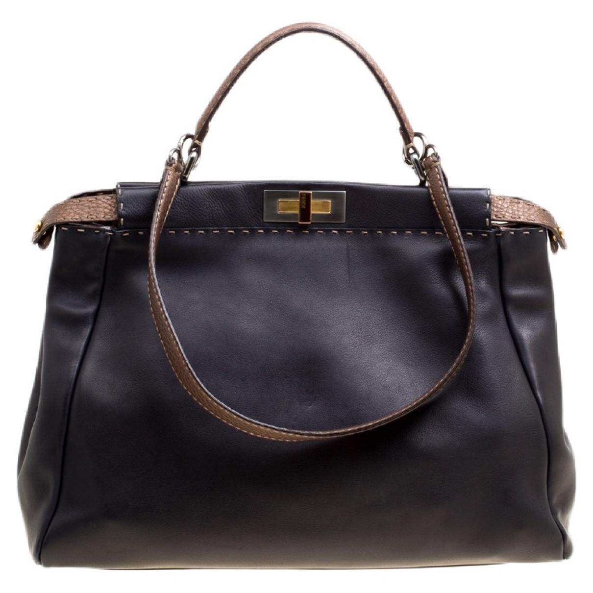 d57ae4781710 Lyst - Fendi Pre-owned Peekaboo Black Leather Handbags in Black