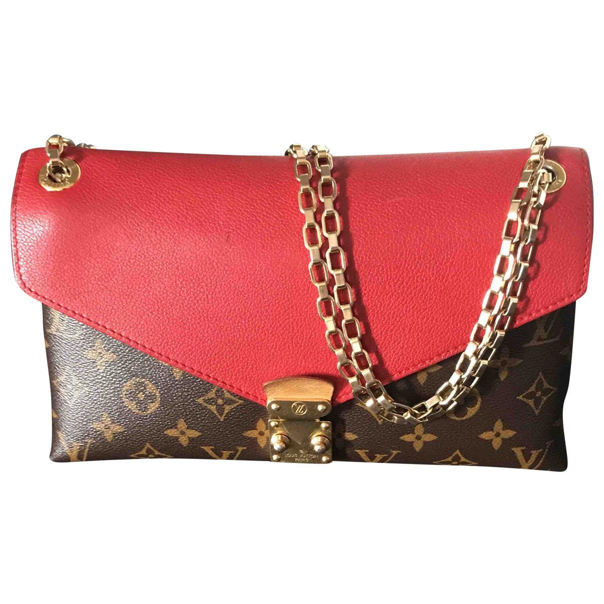Louis Vuitton Pallas Red Cloth Handbag in Red - Save 29% - Lyst 25b178ebeb740