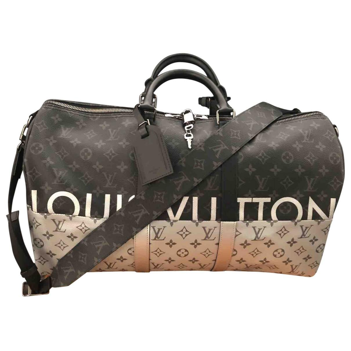 39e994c74cca Lyst - Louis Vuitton Keepall Leather Travel Bag in Black