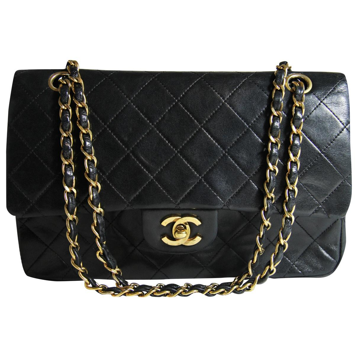 98176d9e46ca Chanel. Women's Pre-owned Vintage Timeless/classique Black Leather Handbags.  £1,916 From Vestiaire Collective