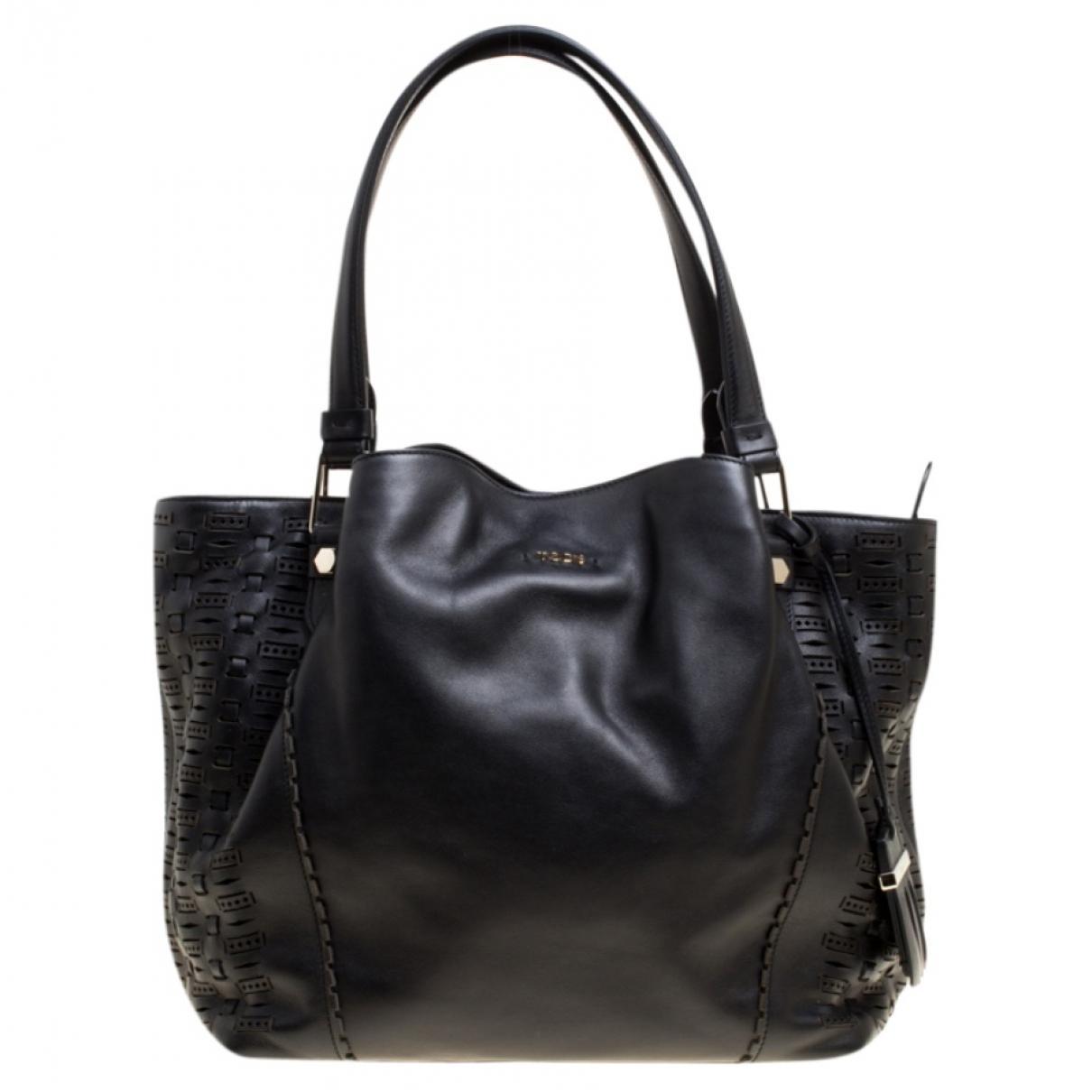 8de9435d6e6 Lyst - Tod's Pre-owned Black Leather Handbags in Black