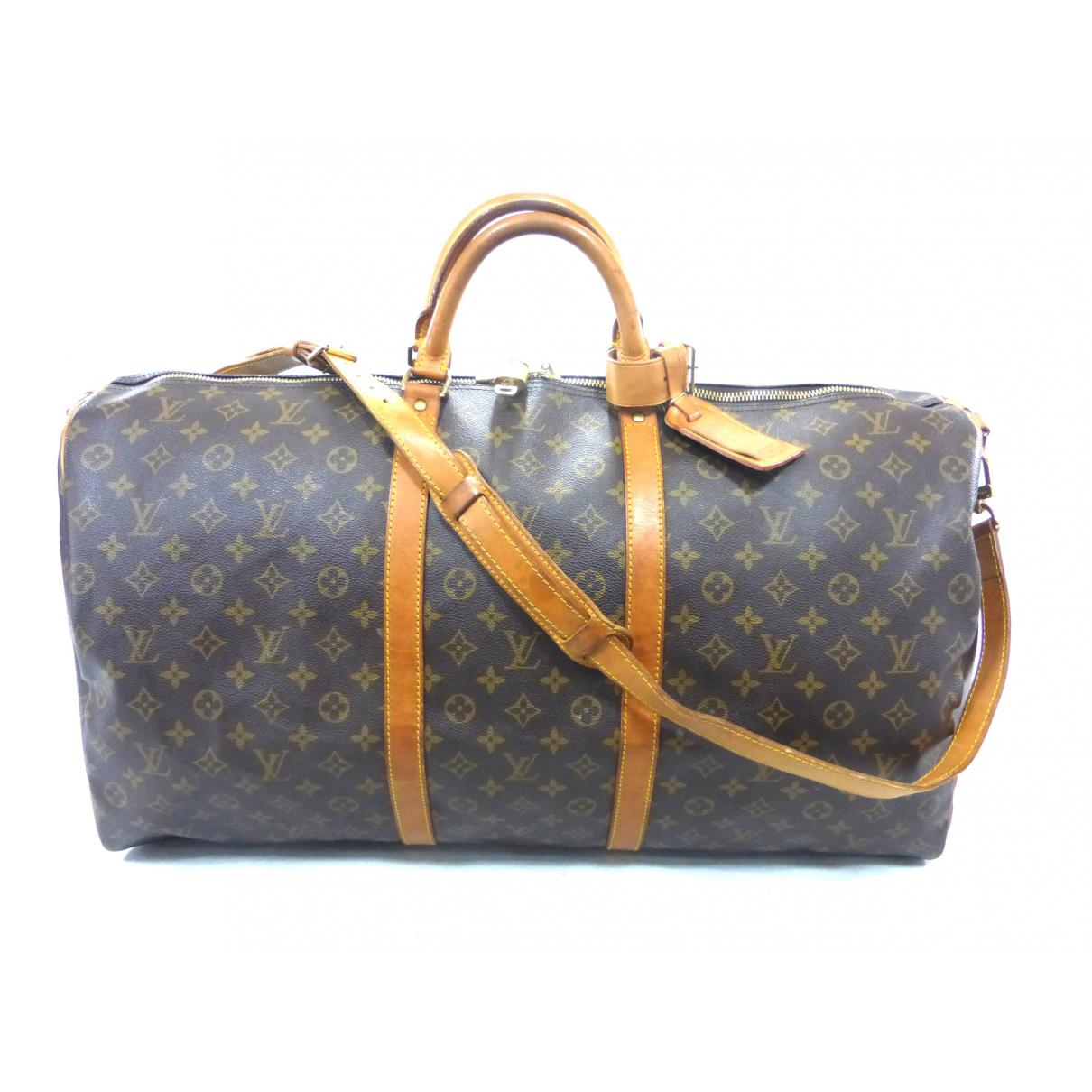 5798e610ea3e Louis Vuitton. Women s Pre-owned Vintage Keepall Brown Cloth Travel Bags