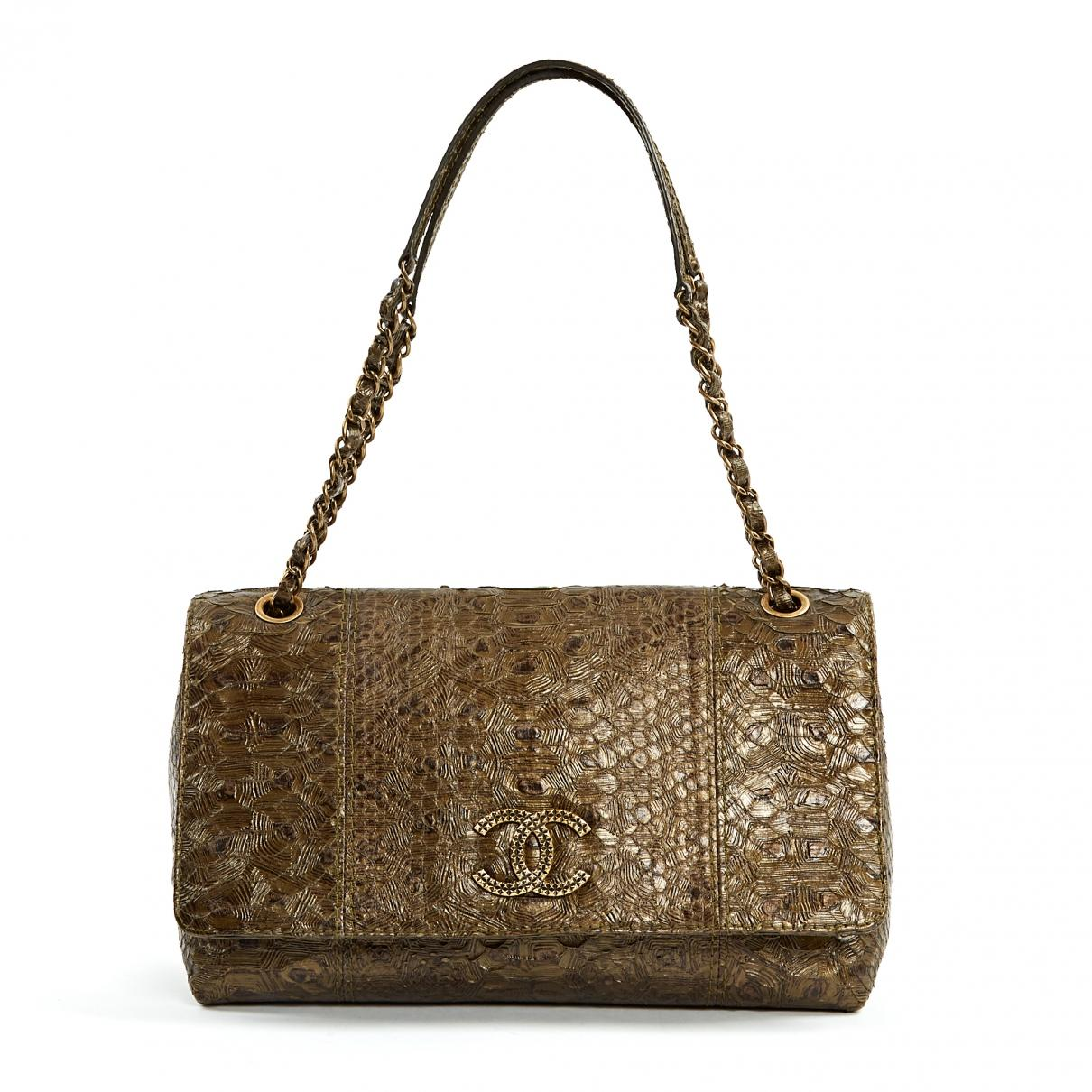 d9635d01ff1a93 Lyst - Chanel Pre-owned Brown Python Handbags in Brown