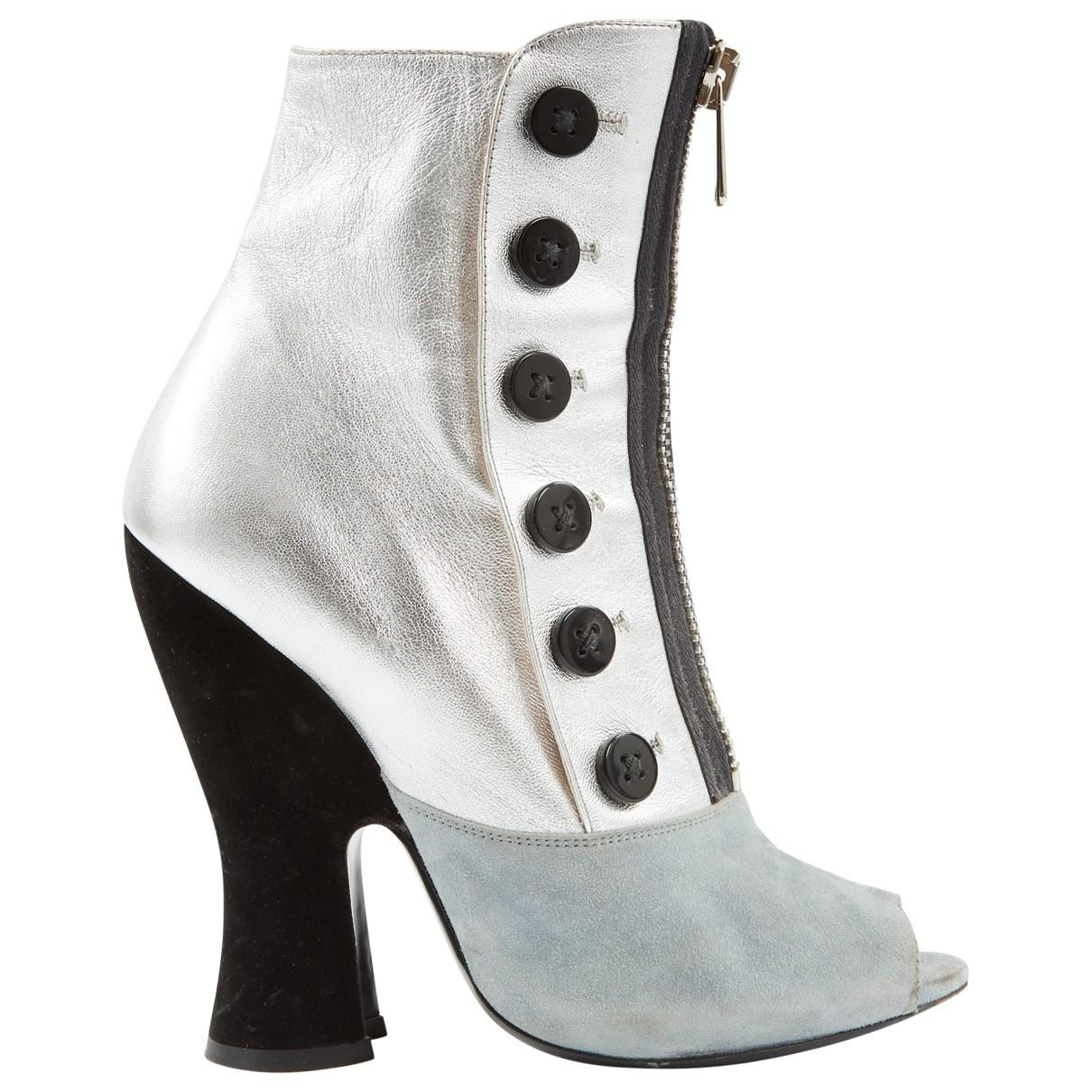 540cc441e6f4 Lyst - Miu Miu Silver Leather Ankle Boots in Metallic