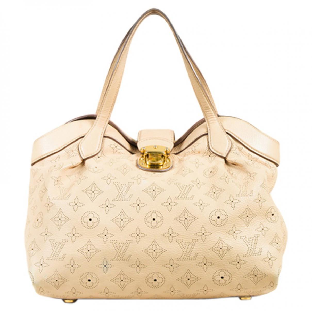 04ea9f1fcd Louis Vuitton. Sac à main Mahina en cuir femme de coloris neutre