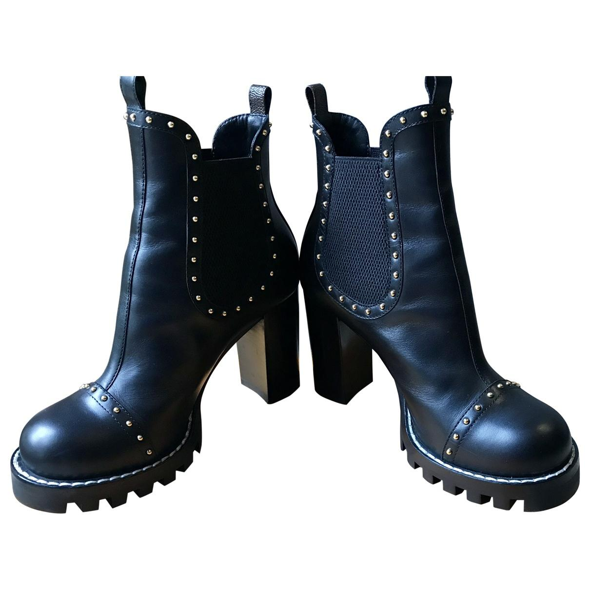 1fb2d1c9e4b7 Lyst - Louis Vuitton Pre-owned Leather Ankle Boots in Black