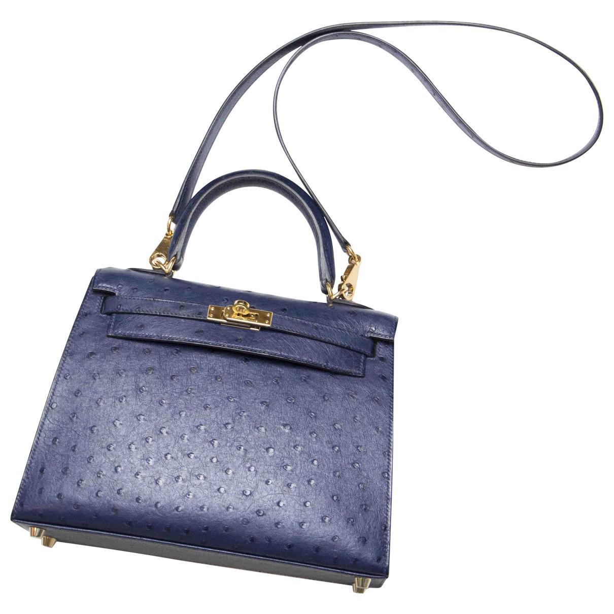 7a081adde55 ... italy hermès pre owned kelly 25 ostrich handbag in blue lyst 22d1f 18b89