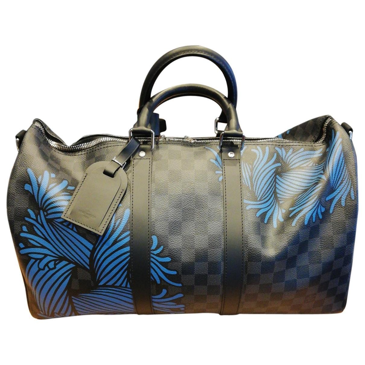 48ea8984b7 Sac week-end Keepall en toile Louis Vuitton pour homme en coloris ...