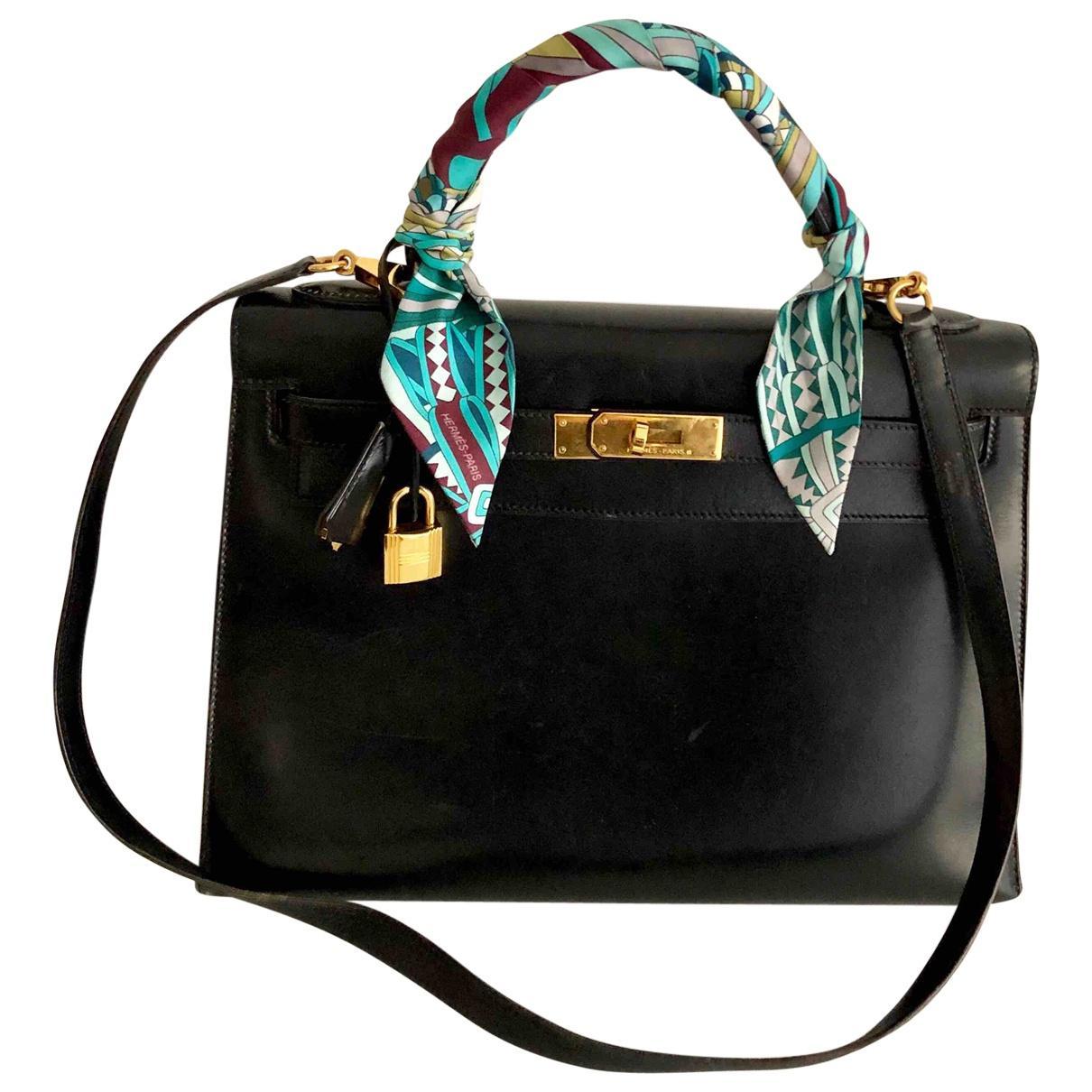 843b902bd0ba Lyst - Hermès Vintage Kelly 28 Black Leather Handbag in Black