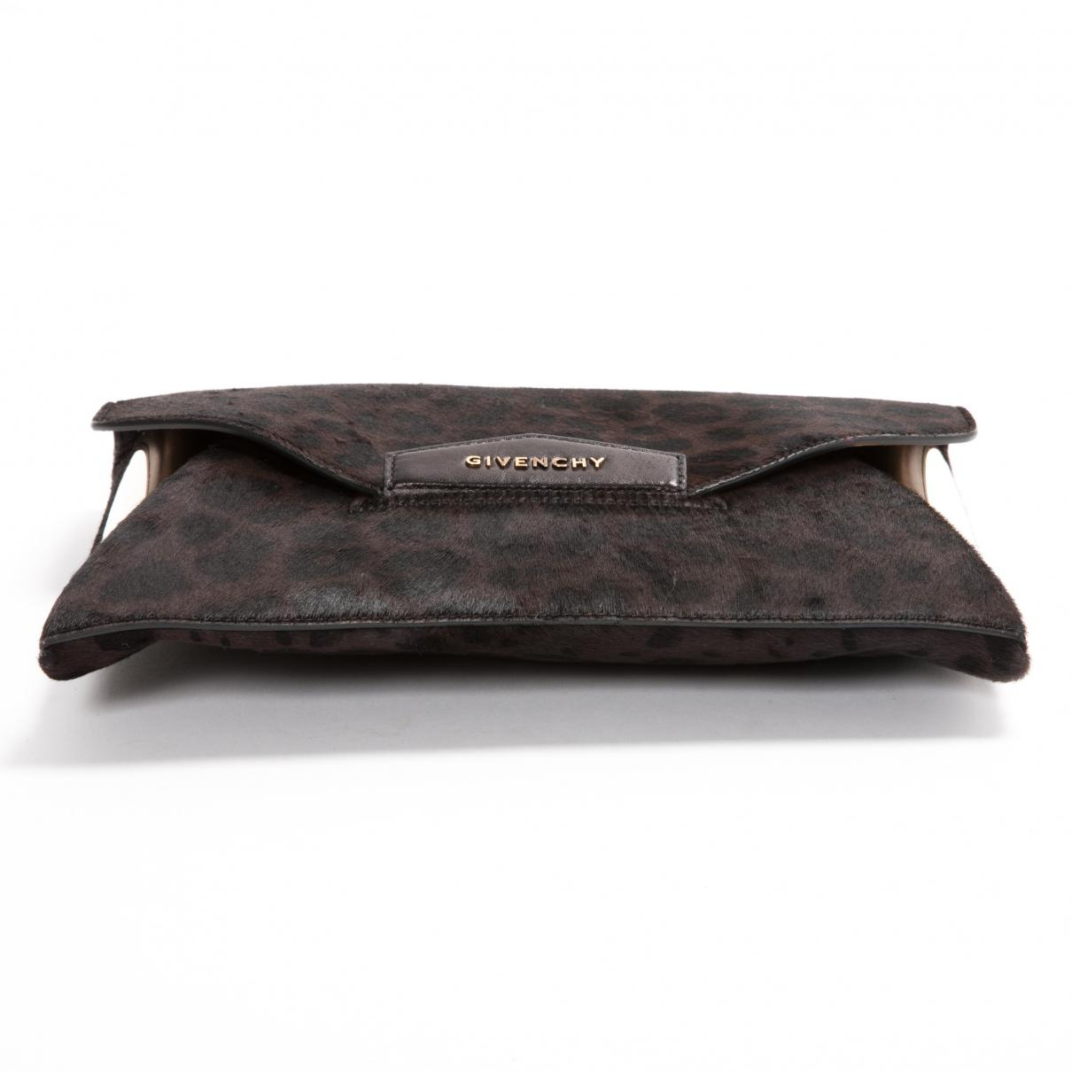 Lyst - Givenchy Brown Pony-style Calfskin Clutch Bag in Brown eed6254b81f25