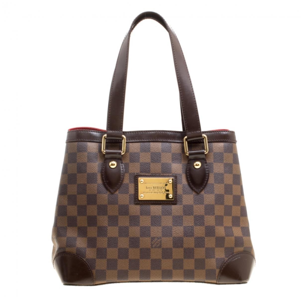 fea2db5fbc53 Lyst - Louis Vuitton Hampstead Brown Leather Handbag in Brown