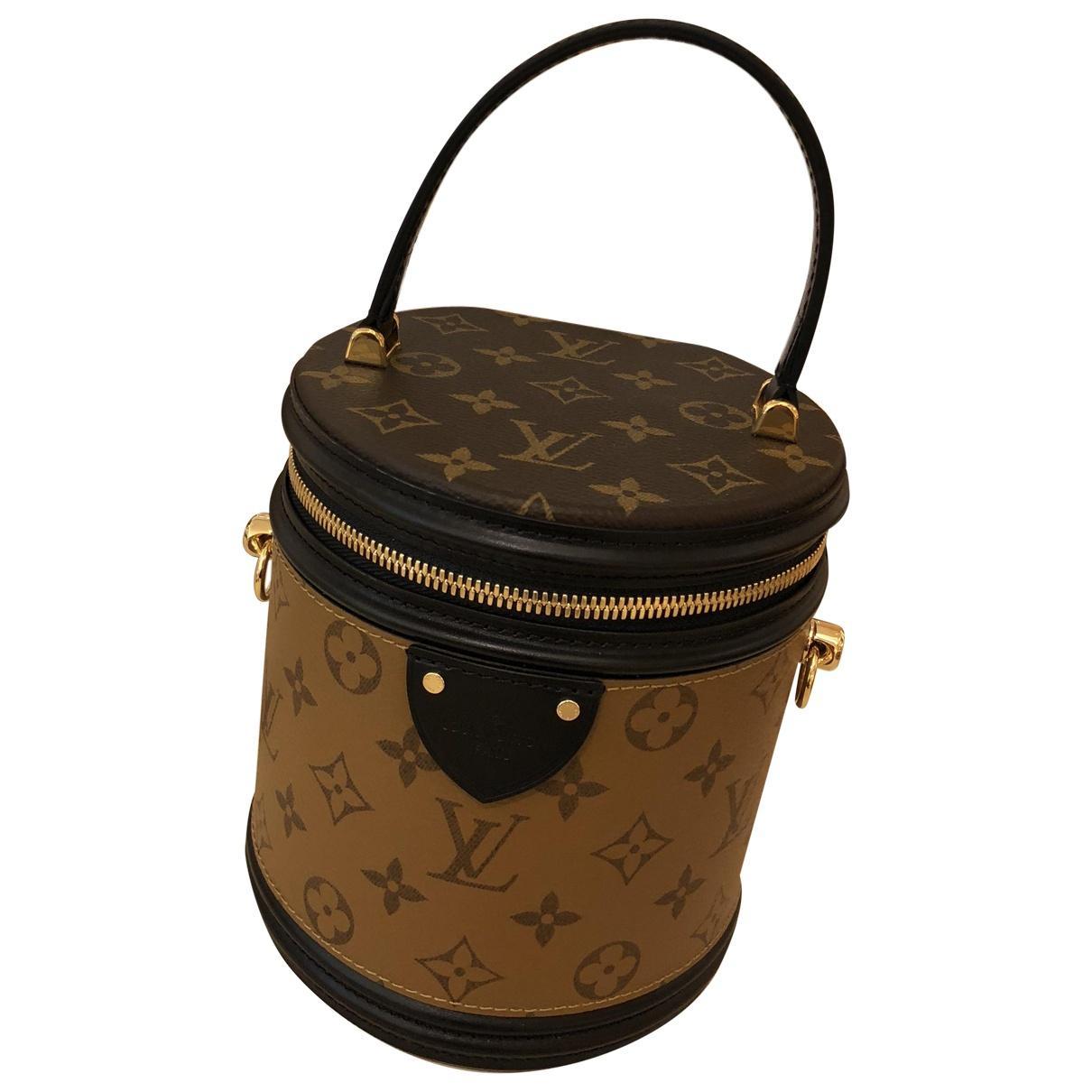 28bd6a37db Louis Vuitton Cannes Brown Cloth Handbag in Brown - Lyst