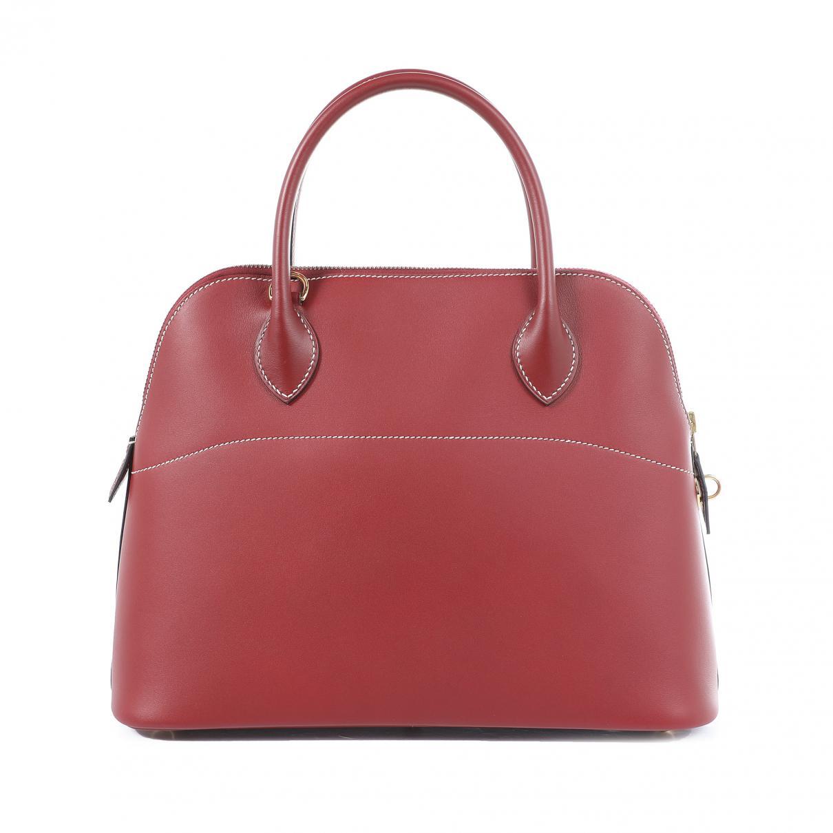 b1f952f9fb53 Hermès Bolide Leather Bag in Red - Lyst