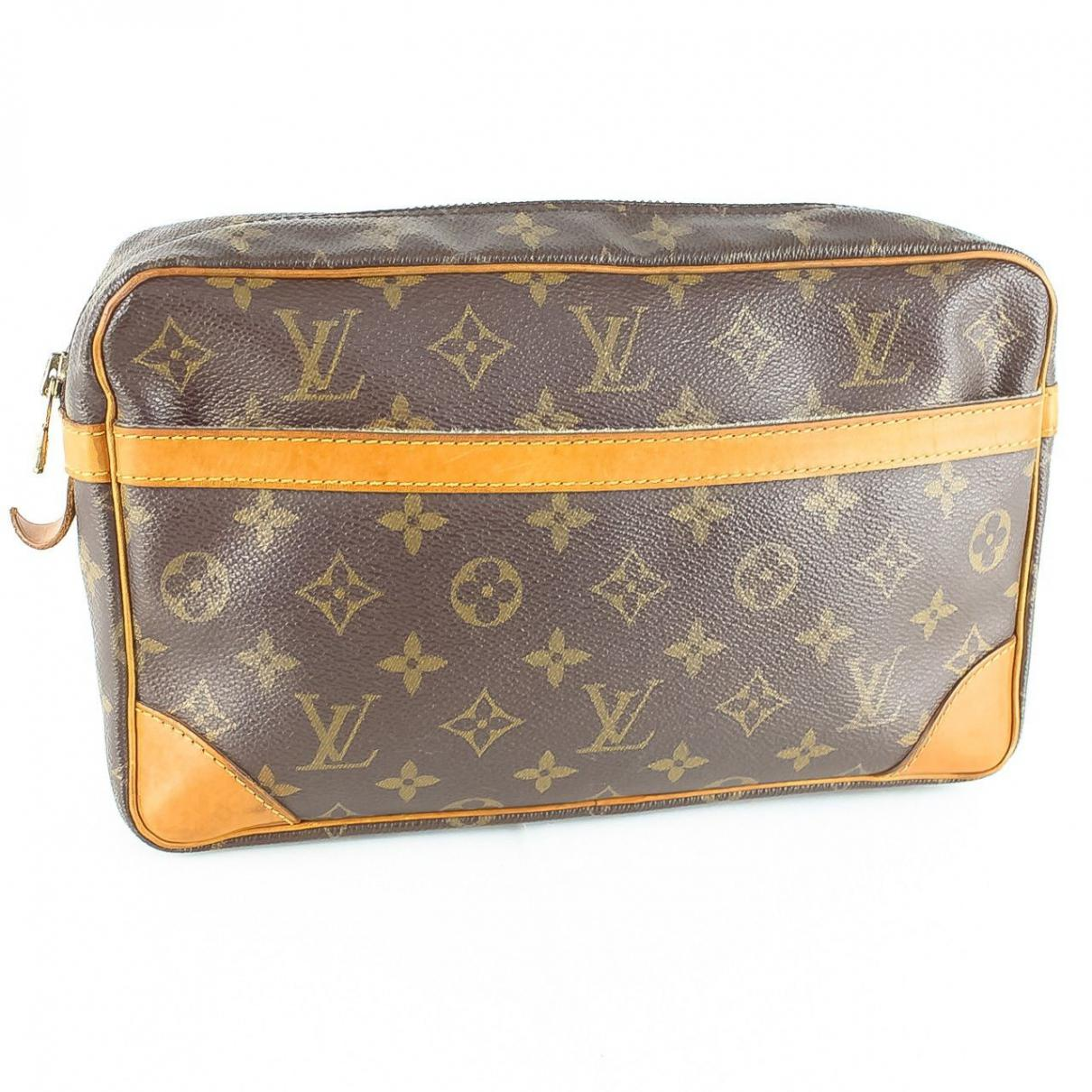 f12859af47e87 Lyst - Louis Vuitton Pre-owned Leather Clutch Bag in Brown