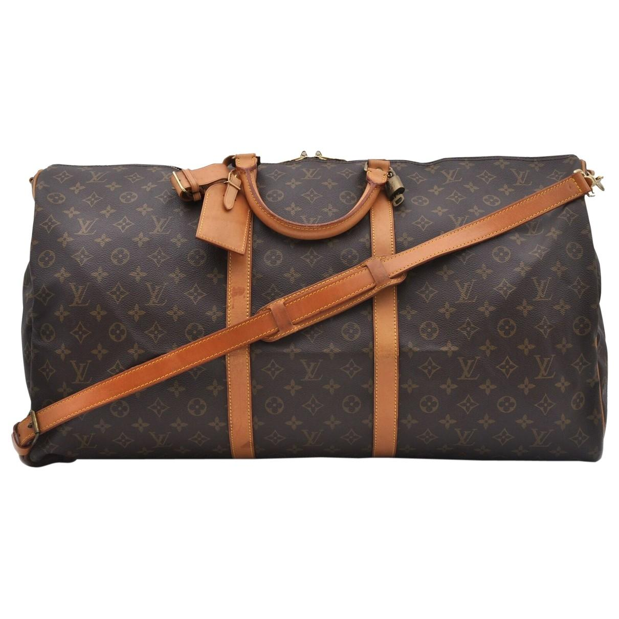 c67698564 Lyst - Louis Vuitton Vintage Keepall Brown Cloth Travel Bag in Brown
