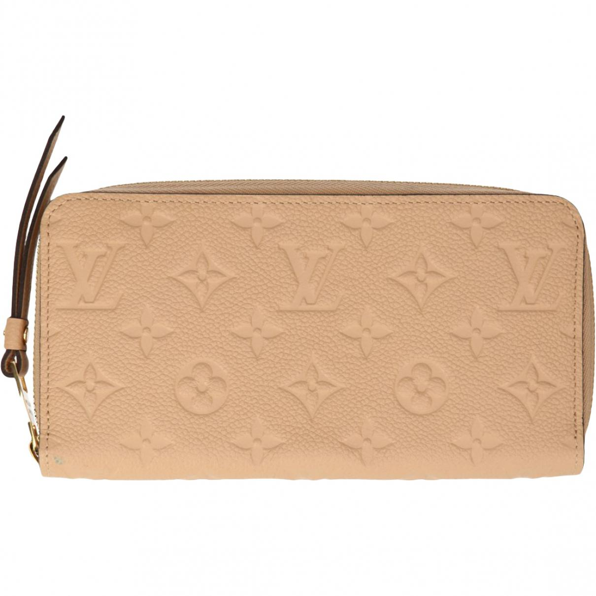 9d59a818361 Lyst - Louis Vuitton Pre-owned Zippy Leather Wallet in Natural