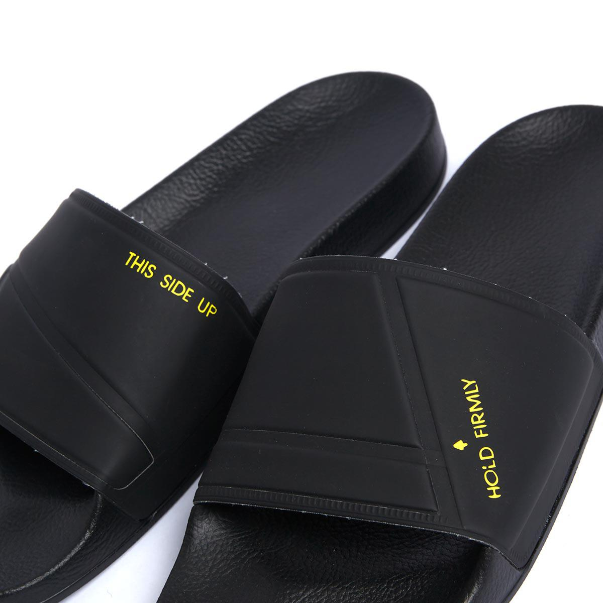 0e19fe03ce83 Lyst - adidas By Raf Simons Bunny Adilette Rubber Slides in Black ...