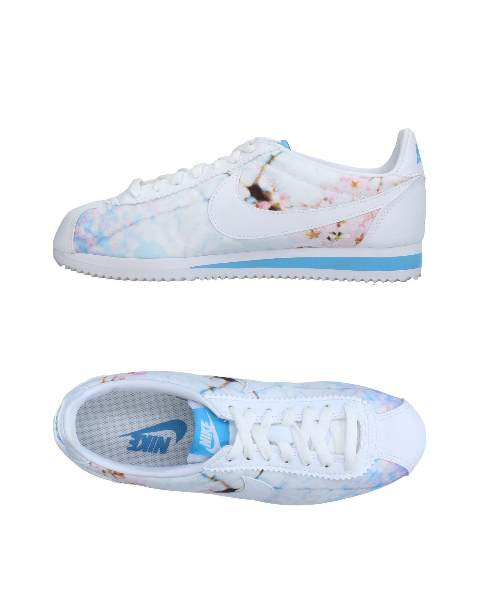 save off f8963 a8b7e Nike. Women s White Classic Cortez Cherry Blossom Leather Sneakers