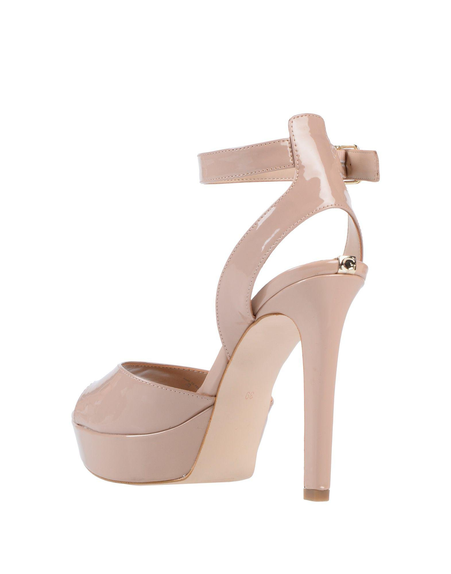 8bb3386352cf Lyst - Guess Sandals in Pink