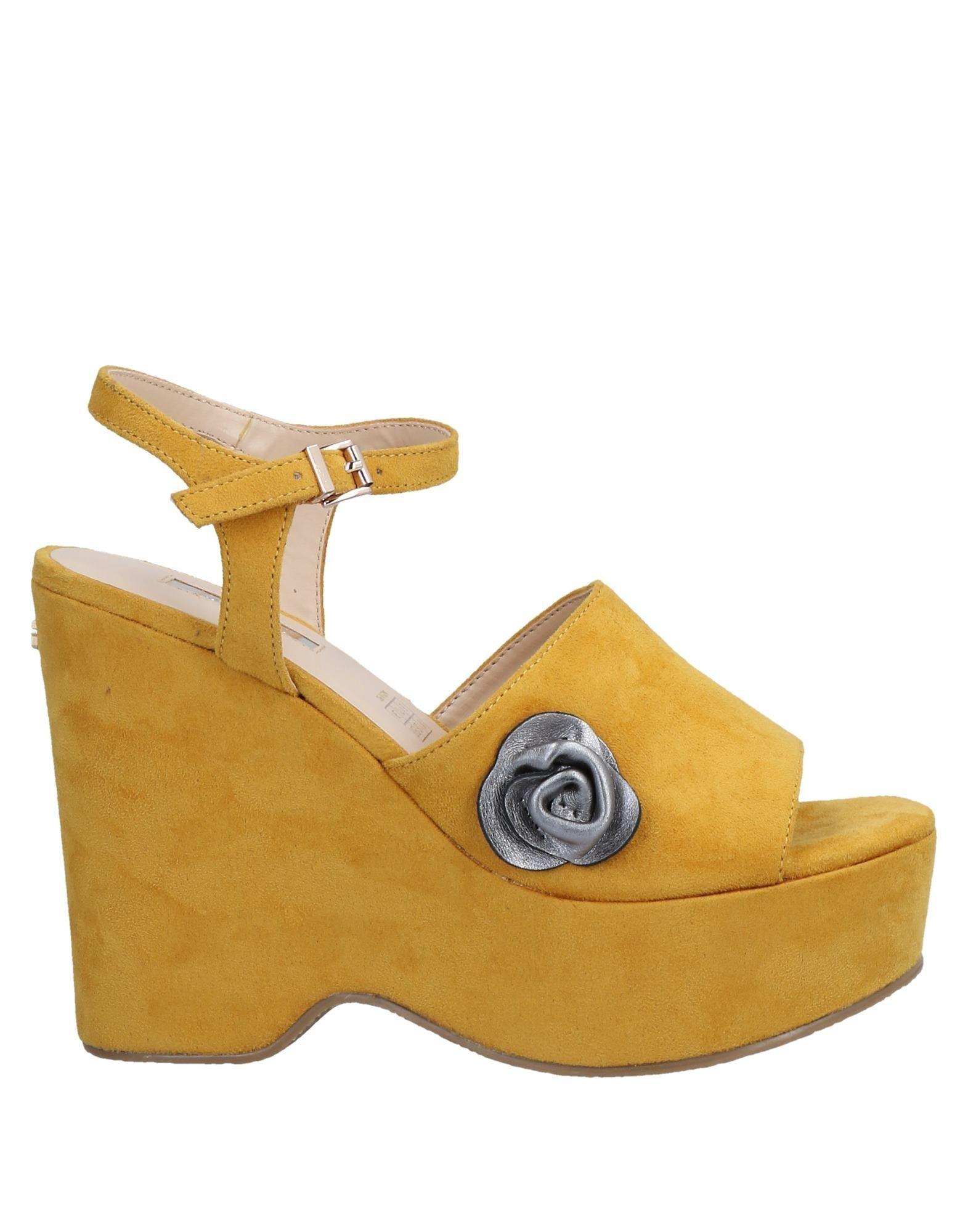 664b5eb0b52937 Lyst - Guess Sandals in Yellow