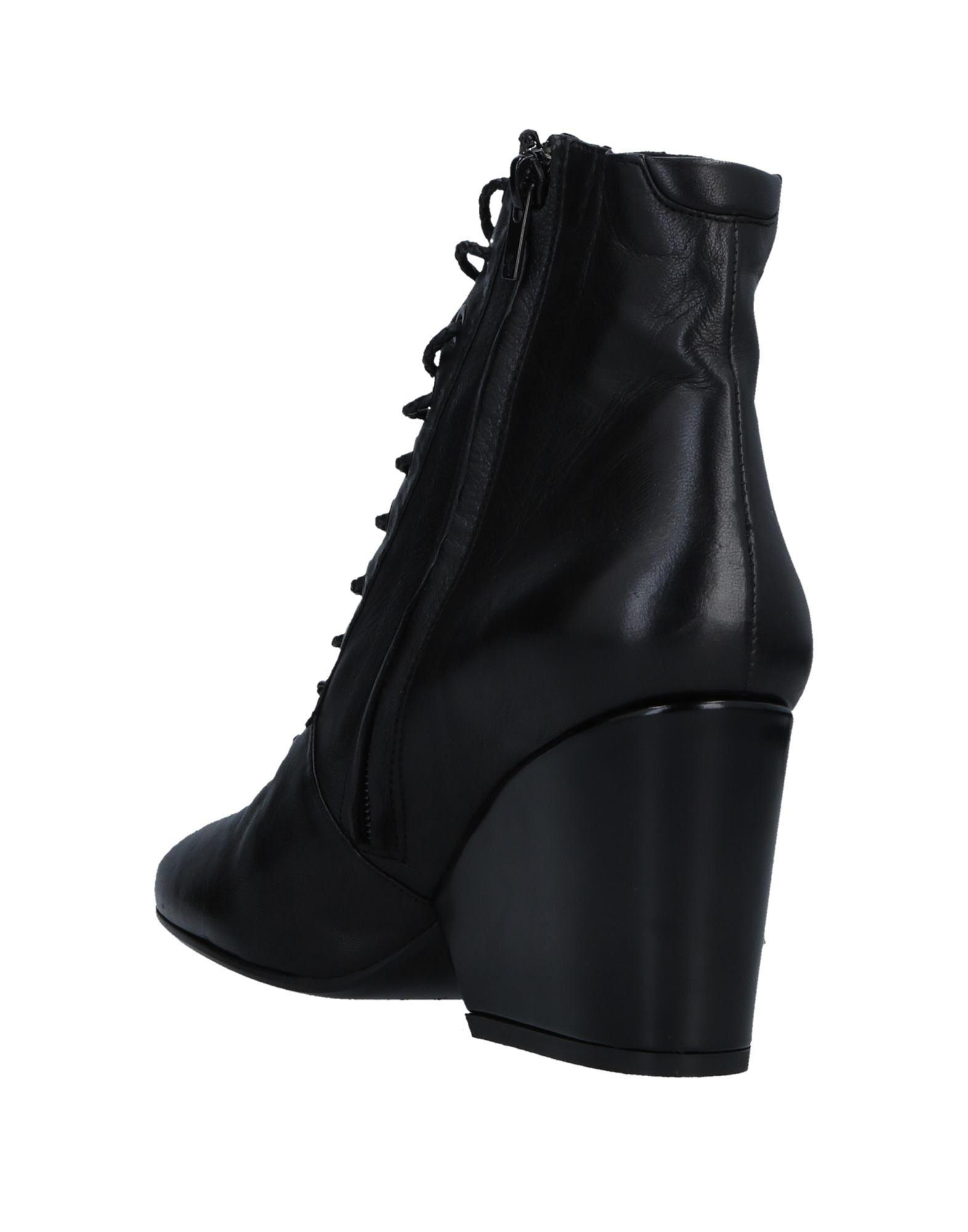 4cf0fa1207e Robert Clergerie Ankle Boots in Black - Lyst