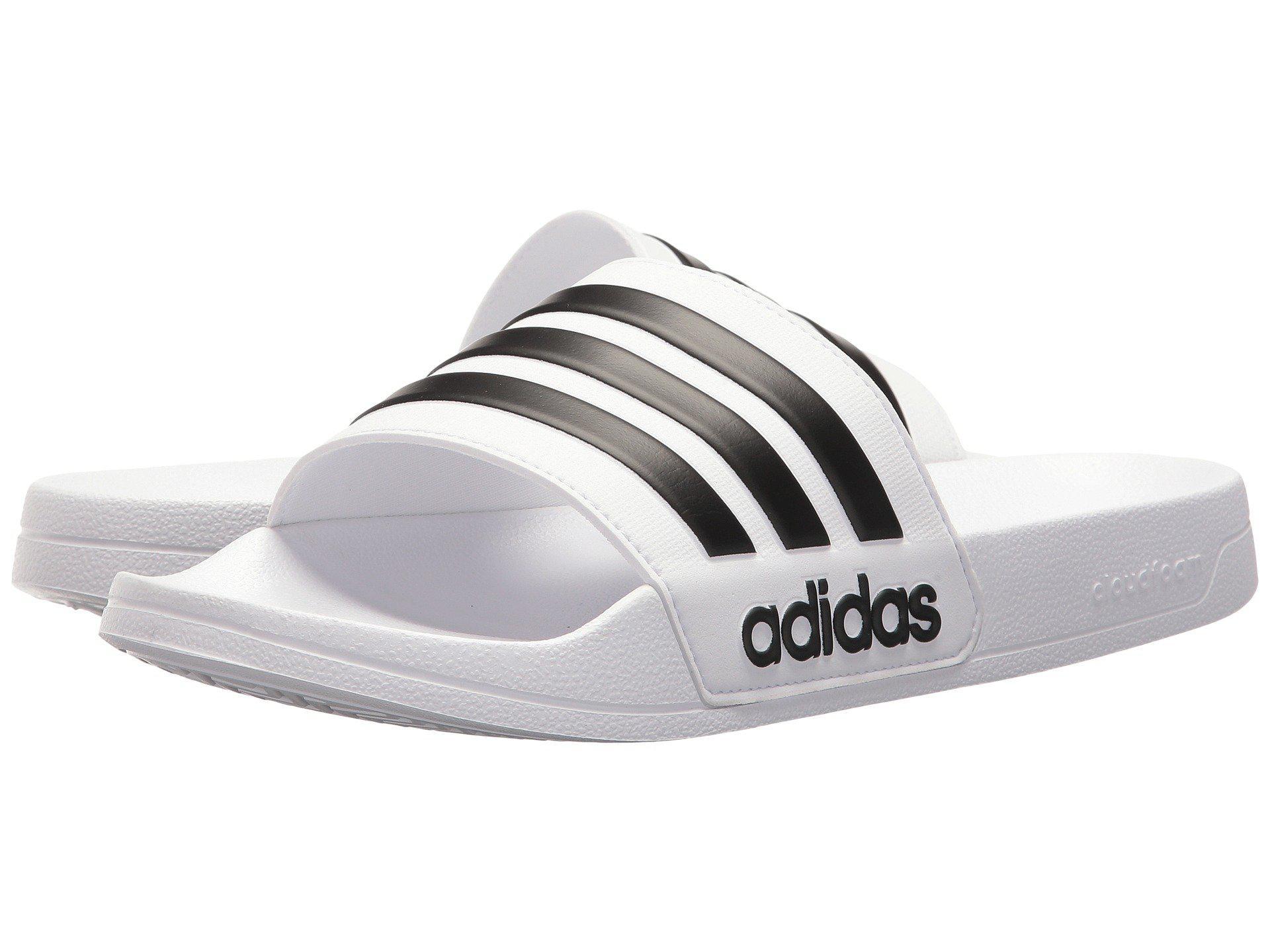low priced bf732 e2450 Adidas - White Adilette Shower Slide Sandals for Men - Lyst. View fullscreen