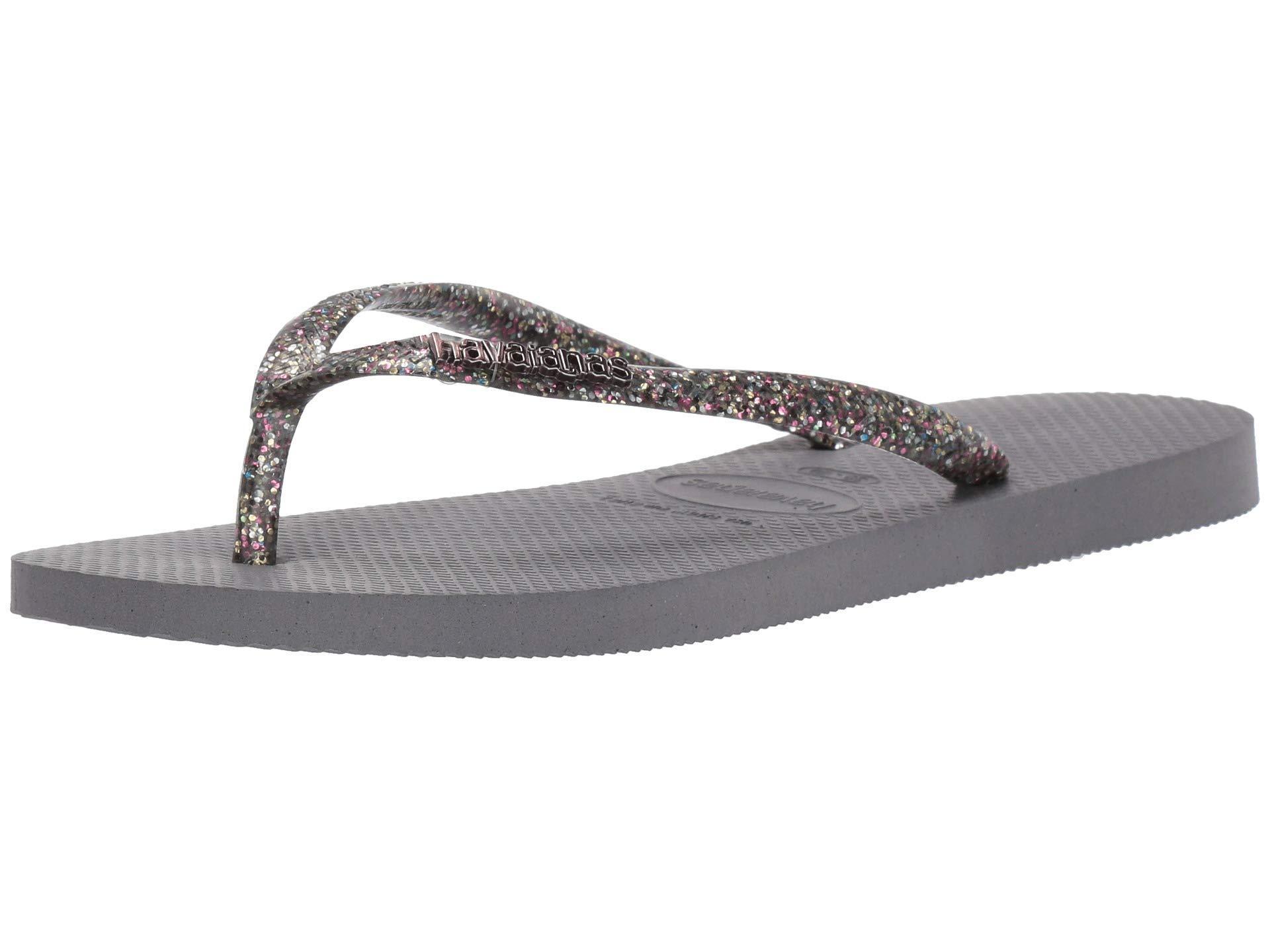 e73c61a8ef65 Havaianas - Gray Slim Logo Metallic Flip Flops (white silver silver)  Women s. View fullscreen