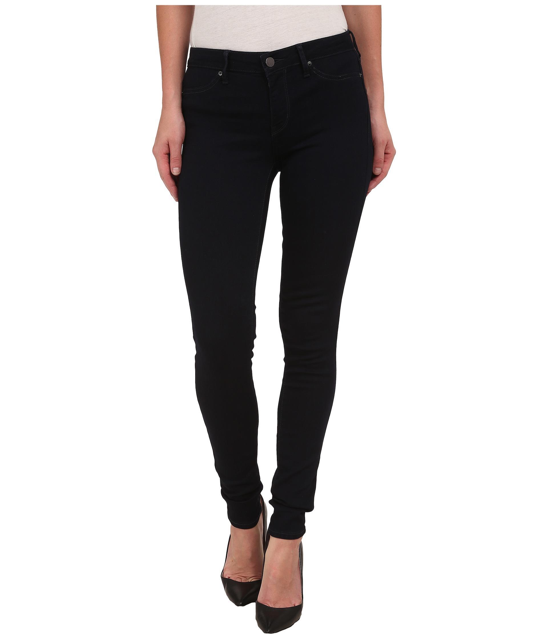 calvin klein jeans denim leggings in dark rinse in black lyst. Black Bedroom Furniture Sets. Home Design Ideas