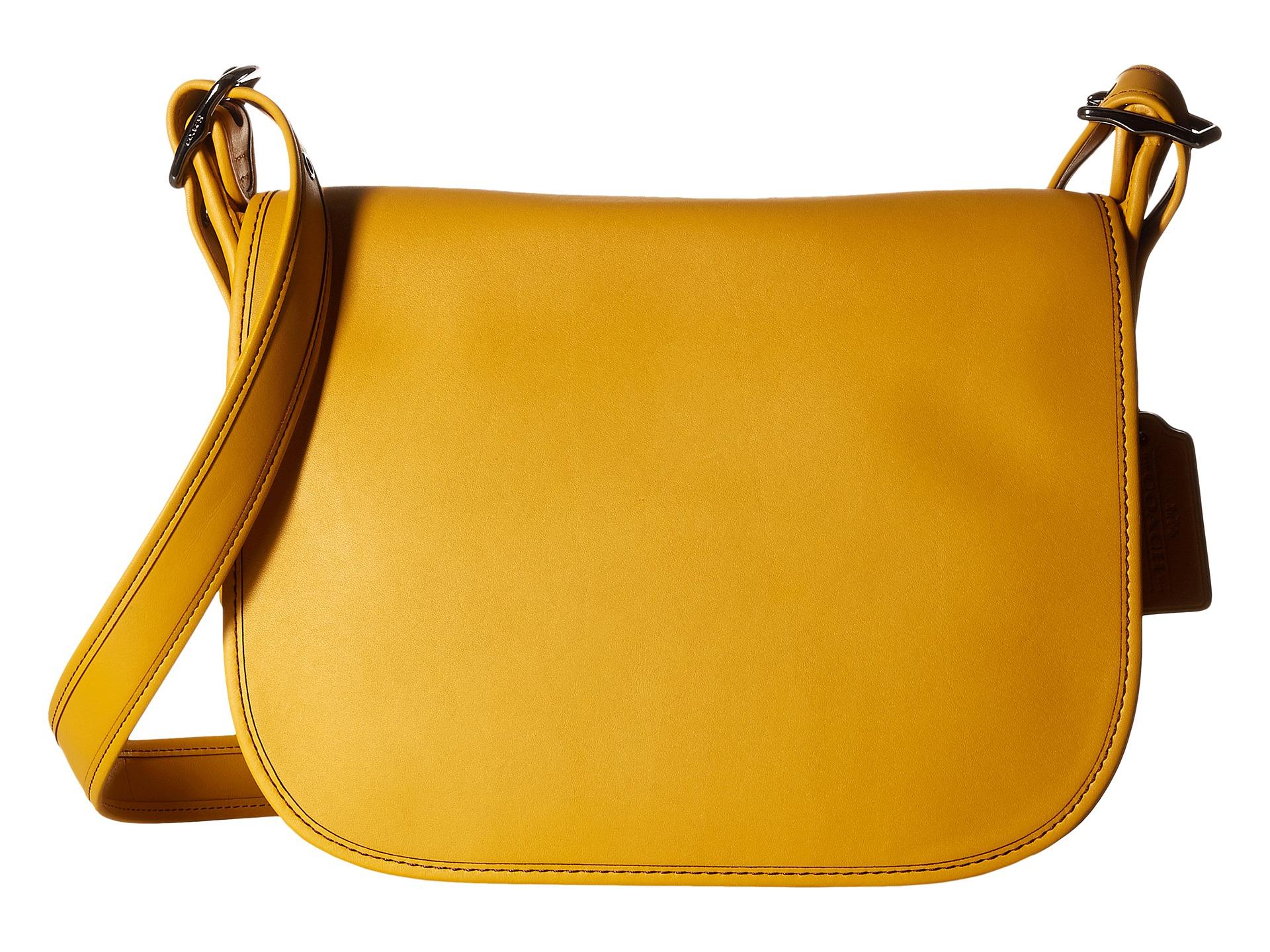 83970a6b5ac ... 23 In Glovetanned Leather - Disney Coach Gloveton Leather Saddle Bag  Lyst ...