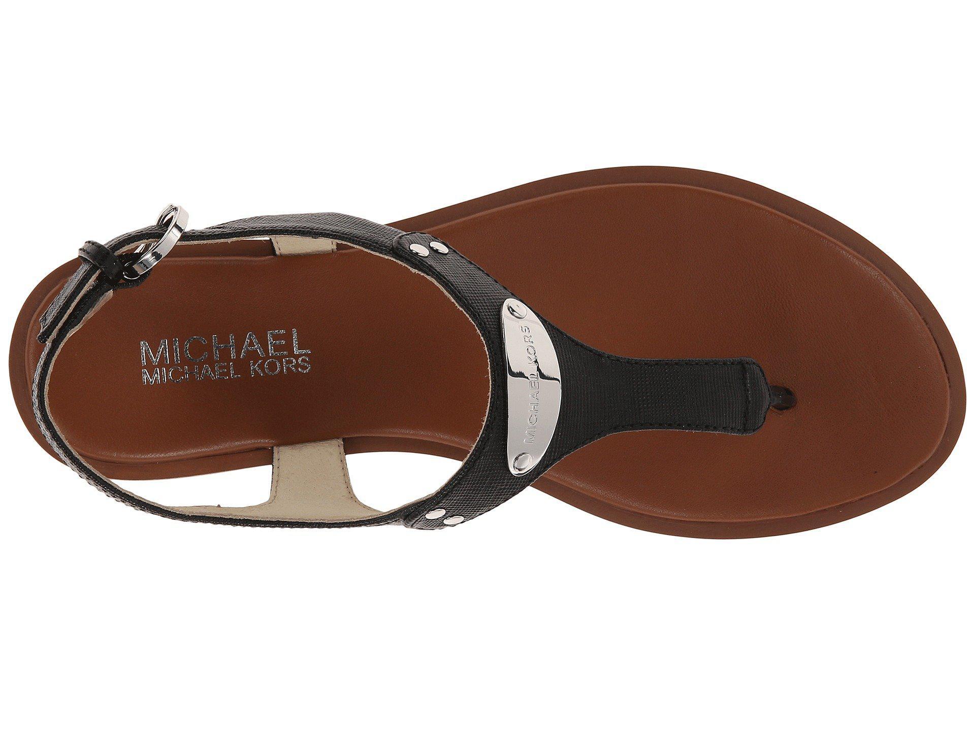 448c81bb7f2b MICHAEL Michael Kors - Black Mk Plate Thong (Luggage) Women s Sandals -  Lyst. View fullscreen
