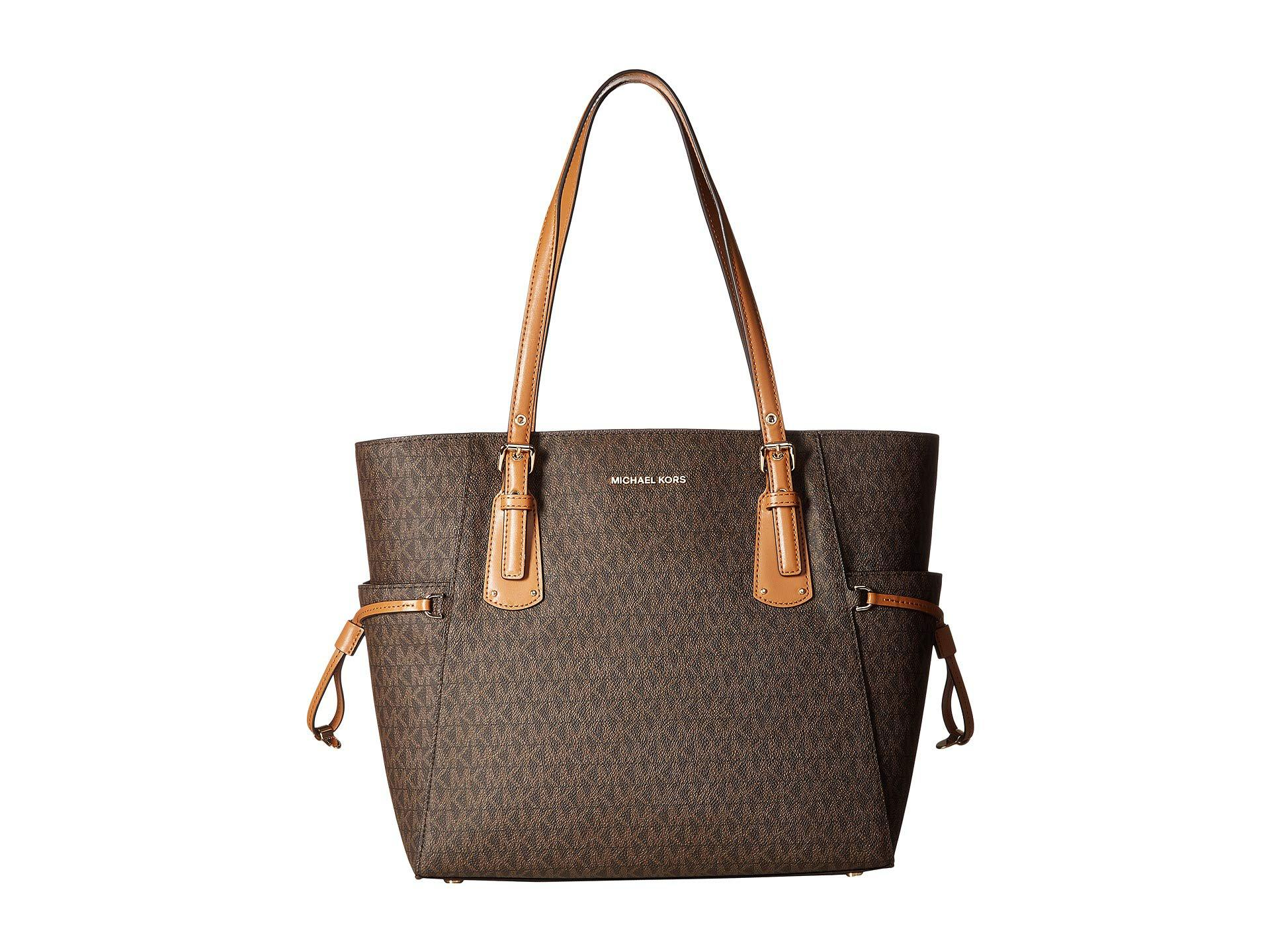 c9b14f301fc1 MICHAEL Michael Kors. Women s Brown Voyager East west Signature Tote ...