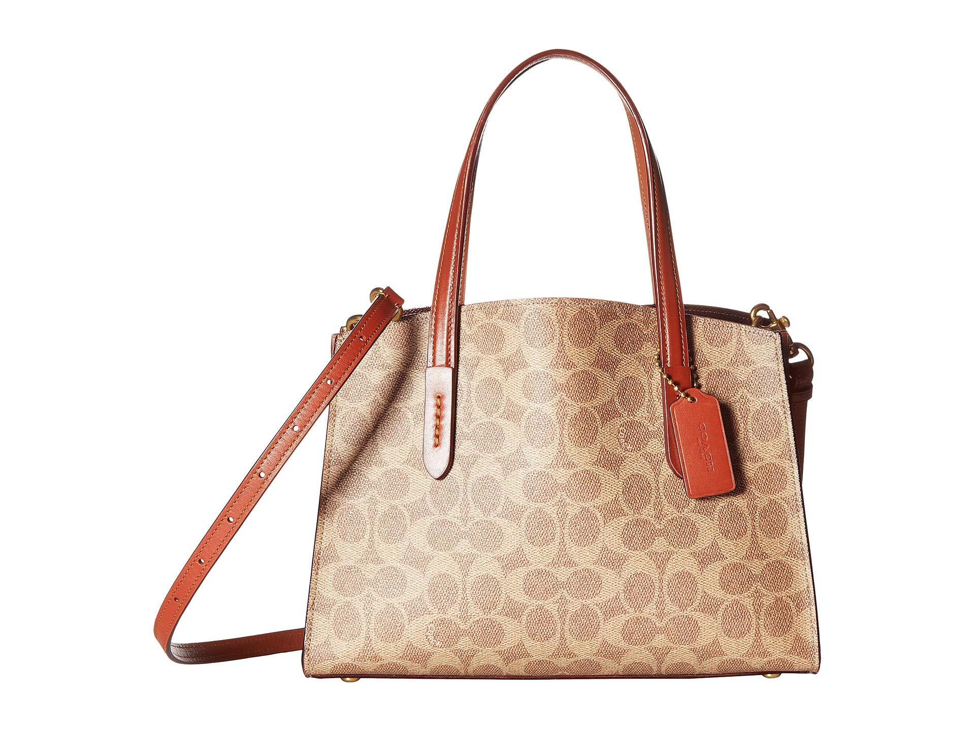 5fbaee7ec4e4 Lyst - COACH Coated Canvas Signature Charlie 28 Carryall (b4 rust ...