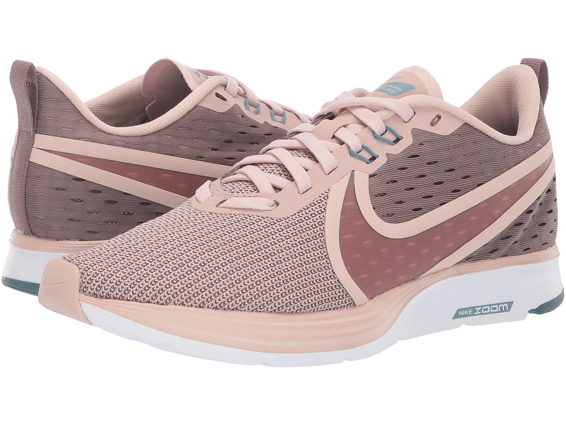 e2748fe1e119f Nike. Zoom Strike 2 (gunsmoke oil Grey lava Glow white) Women s Running  Shoes