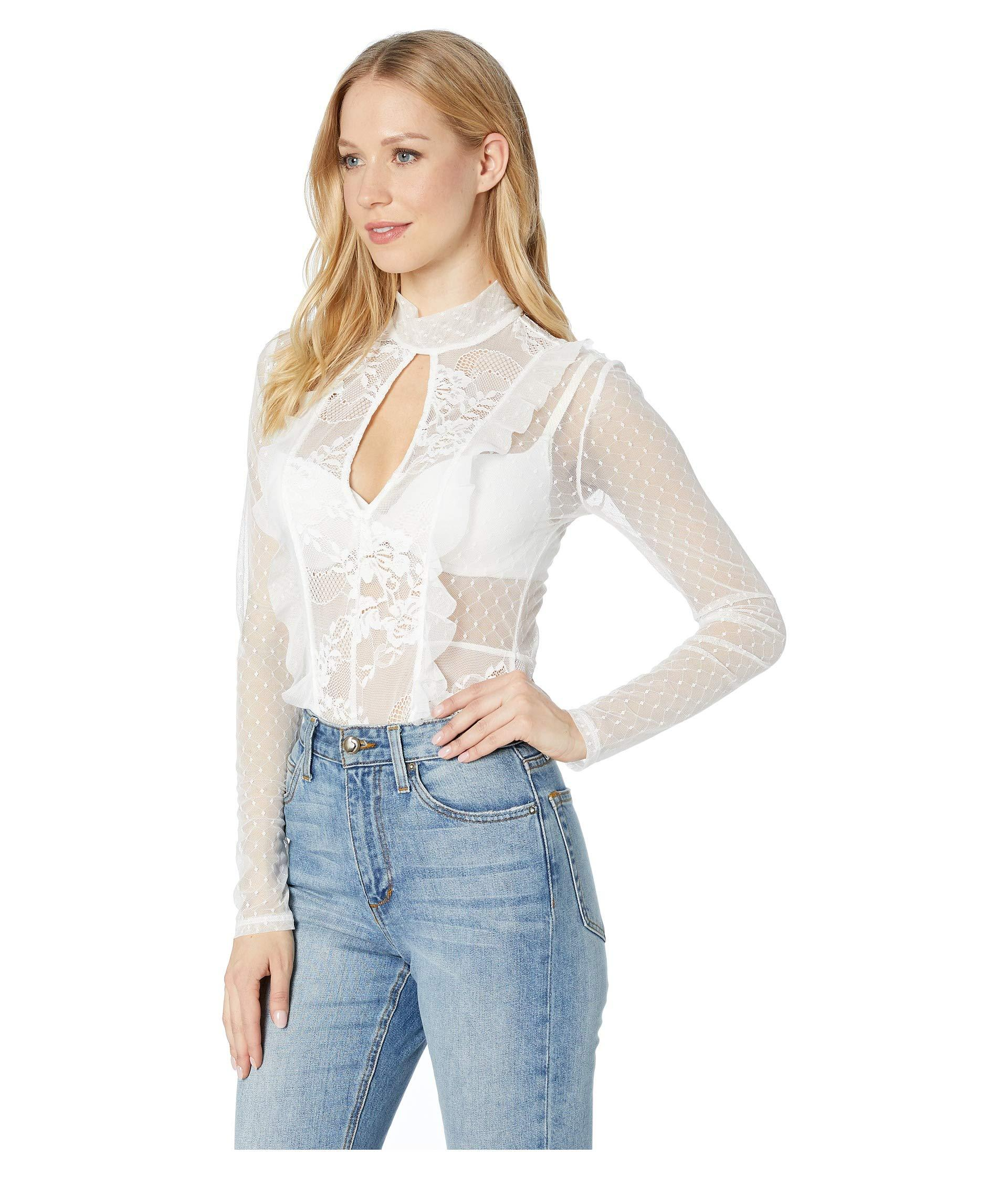 ce2d41897b Lyst - BCBGMAXAZRIA Long Sleeve Lace Cut Out Bodysuit (optic White) Women s  Jumpsuit   Rompers One Piece in White