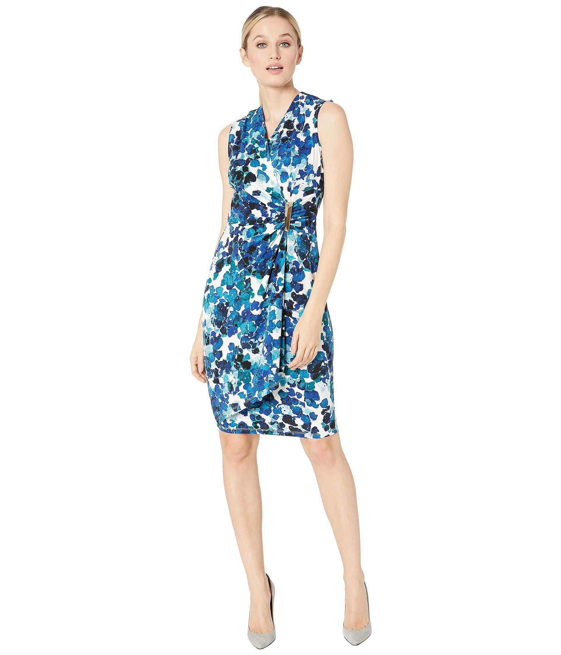 f97e5007a2 Calvin Klein. Blue Sleeveless Floral Print Faux Wrap Dress With Side ...