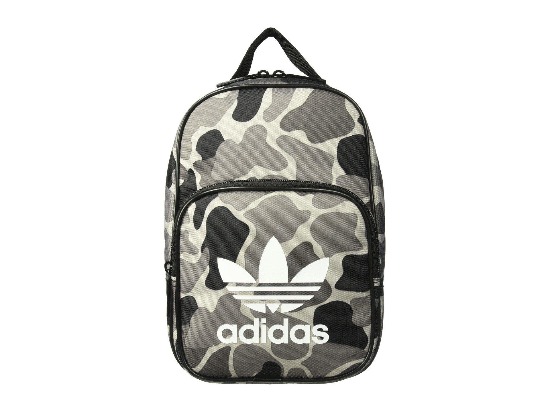 5385b6082e adidas Originals. Women s Originals Santiago Lunch Bag (camo Aop Carbon  black white) Bags